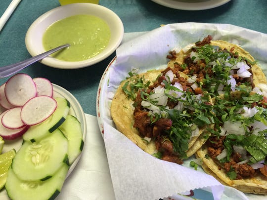 Tacos from Taqueria El Rinconcito in Lehigh are served with spicy salsa verde, and cucumbers and radishes for cleansing your palate.