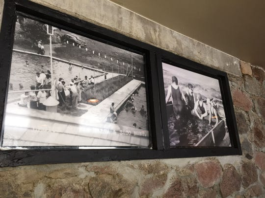 Historic photos of the Sleeping Buffalo Hot Springs, then the American Legion Health Plunge Resort, decorate the renovated resort north of the Hi-Line.