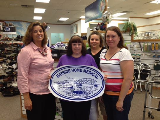 Bayside Home Medical manager Lori Christel, left, stands with coworkers Shelly Eckert, Dodie Whitmore and Michelle Denil. The medical equipment store at 1300 Egg Harbor Road in Sturgeon Bay opened Monday under its new name after the pharmacy portion of the business at Bay Pharmacies was transferred to CVS pharmacy a block away.