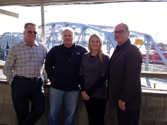 Jason and Laura Estes, owners of Sonny's Pizzeria, are flanked by Bob Wolter left, and Michael Schwantes of Creative Business Services, on the outside deck of the former Applebee's that overlooks the Michigan Street Bridge in Sturgeon Bay. The Estes plan to buy the shuttered restaurant and move their pizzeria from 43 S. Madison Ave. to expand.