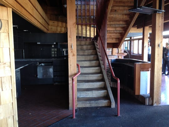 Jason Estes plans to remove this central staircase to make room for more tables on both levels of the restaurants he plans to reopen as two businesses by February.