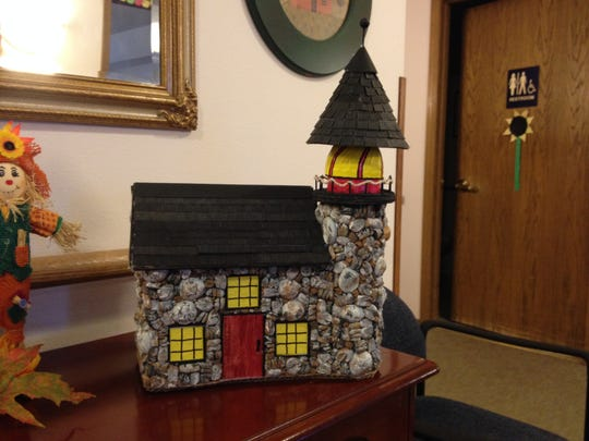 This lighthouse was hand crafted by a resident at Bay Road Place in Algoma using recyclable materials.