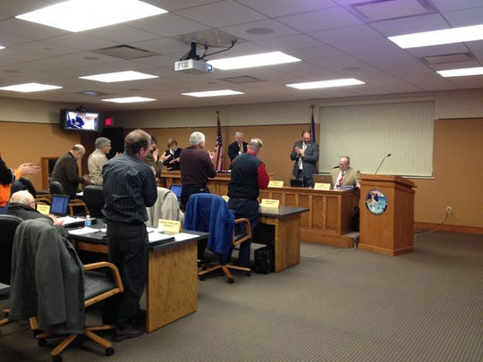 Dorner receives a standing ovation at the Dec. 16 County Board meeting.