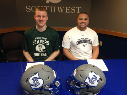 Southwest seniors Noah Meyer (left) and Kieran Thomas (right) sign their national letters of intent.