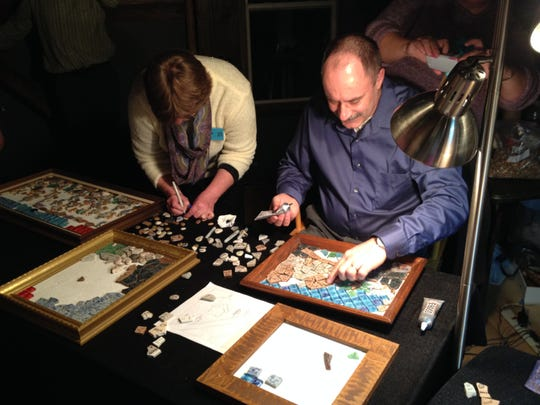 Kim and John Lyon create mosaics with more than 4,000 pebbles during the VIP benefit. Each pebble represents a person who received services from VIP in the last 25 years.