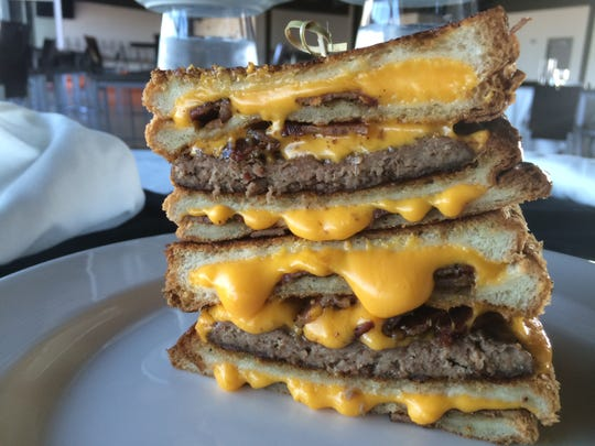 The Grilled Cheese Bacon Cheeseburger Stacker was the first of two new food items to get plenty of Twitter exposure.
