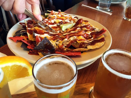 The famous BBQ nachos can be order with pulled pork or vegetarian. To keep them in tact, Big Woods recommends slicing it like a pie to serve.