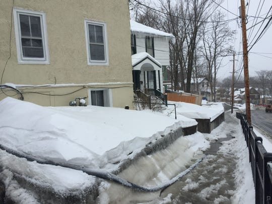 A basement is pumped out on the 100 block of Prospect Street. Parts of East Clinton and South Aurora streets were closed at 10 a.m. Sunday. A water main break had occurred at the South Aurora and Pleasant Street intersection. Emergency personnel were detouring traffic onto Hudson Street.
