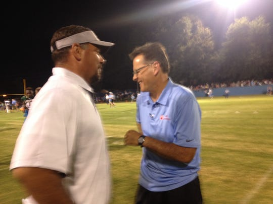 USJ coach Mickey Marley and South Side coach Jason Driggers share a laugh.