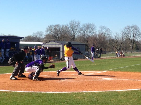 Sam Seaton hits a single Saturday. The junior from Millington was 4-for-5 with four runs batted in in a 12-3 win.