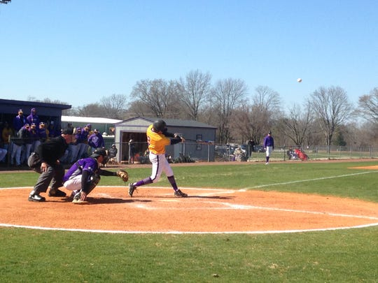 Milan native Taylor Paterson makes contact during Bethel's 12-3 win Saturday afternoon.