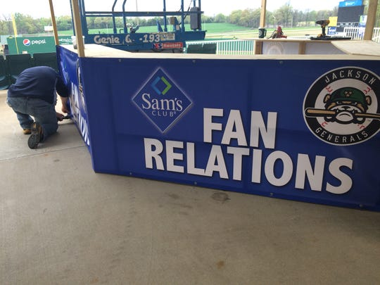 A Jackson Generals' staff worker finishes the new Fan Relations booth at the front gate to The Ballpark at Jackson on Tuesday.