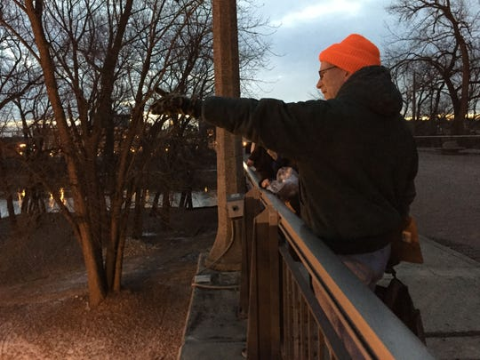 Kurt Harker, a case manager for Wabash Valley Alliance, points from the John T. Myers pedestrian bridge Thursday, Jan. 29. Harker was a team leader for much of the day for the 2015 Point-in-Time homeless count.
