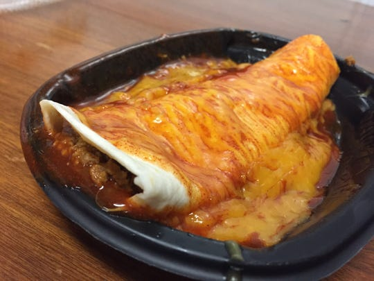 Taco Bell's Enchirito is stuffed with beef, refried beans and onions, and it's topped with enchilada-style sauce and cheese.