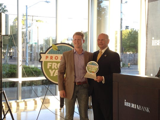 A River Ranch representative was presented a Mayor-President's Front Yard Award Tuesday by Joey Durel.