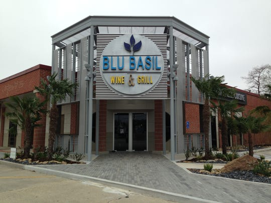 Blu Basil Wine & Grill opens to the public today at 4 p.m. with a dragon and lion dance.