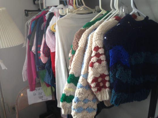 Some of Ruth Coan's handiwork hangs at Our Savior Lutheran Food Bank in Lansing, but not for long. Soon these sweaters will be keeping children warm.