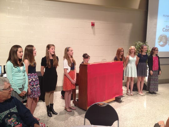Members of the West Middle School choir, under the direction of choir teacher Janine Grady, performed at the forum.