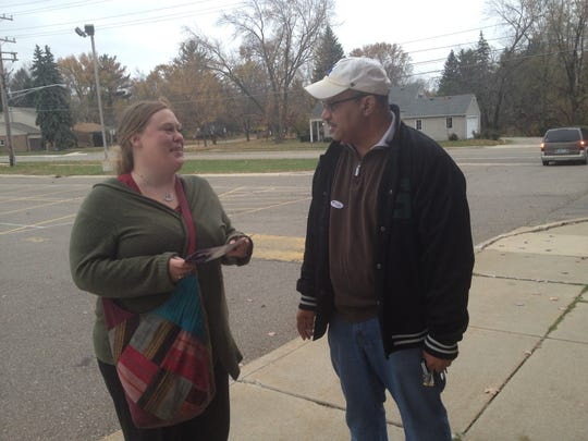 Bridgid Holloway of Farmington chats with FPS Board of Education candidate Terry Johnson prior to casting her vote.