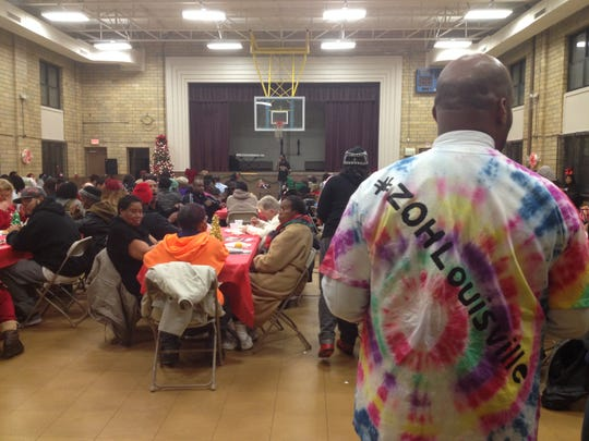 Anthony Smith, in his Zones of Hope T-shirt, looks out onto the crowd gathered Dec. 16, at the Vision of Hope Holiday Feast in the Baxter Community Center. The celebration united the four neighborhoods targed by the Zones of Hope initiative, which is a city effort trying to tackle issues of education, unemployment and violence by focusing on young black males.