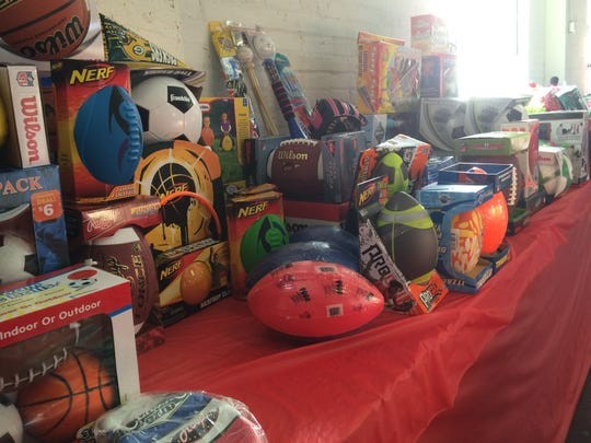 Various balls and sporting memorabilia wait to be claimed in the Salvation Army Toy Shop in Manitowoc County. The items are donated by the community through Toys for Tots.