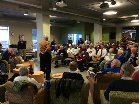 David Hansen, center standing among post-WWII veterans, shares stories of his experiences from Vietnam to a crowd of Lincoln High School students and other veterans Dec. 2 at Concordia University Wisconsin in Mequon.