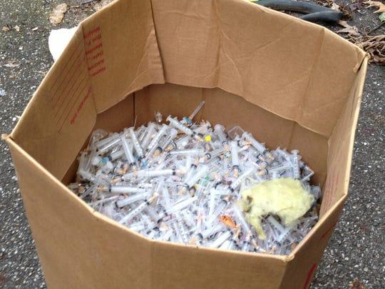 Thousands of syringes 1 closeup jpeg.JPG
