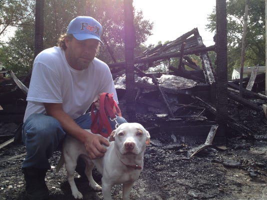 MNJ 0901 Dog saves man from fire 1