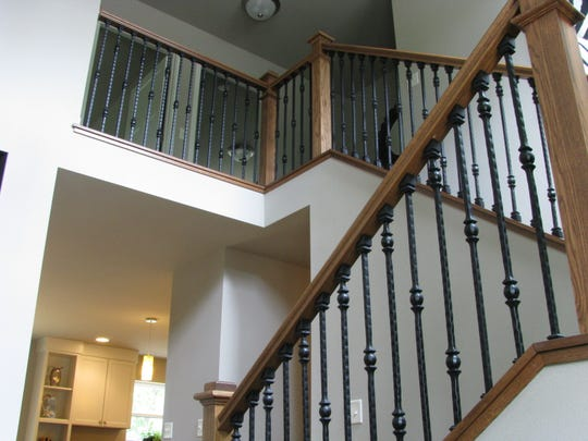 Wrought-iron balusters with oak stair parts.