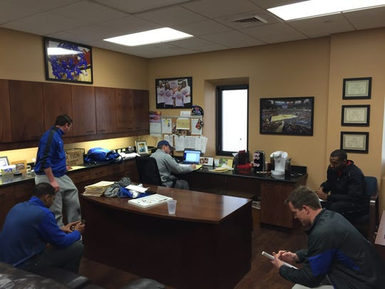 Louisiana Tech's coaches discuss Saturday's practice during a staff meeting.