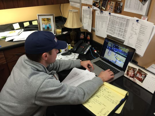 Louisiana Tech basketball coach Michael White looks at tape from his team's game at Southern Miss. White led the Bulldogs to the C-USA title.