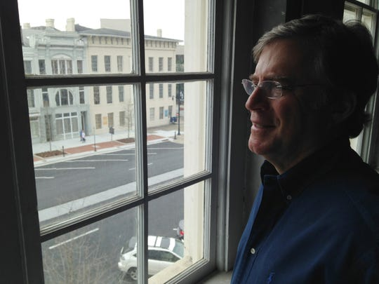 Montgomery developer Jerald Labovitz looks down on construction from 25 Dexter Ave.