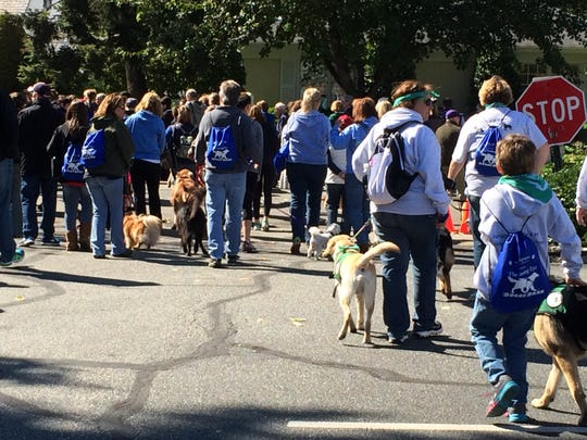 Participants walk the mile with their dogs in Morristown on Sunday at the Doggy Dash fundraising walk, sponsored by The Seeing Eye.