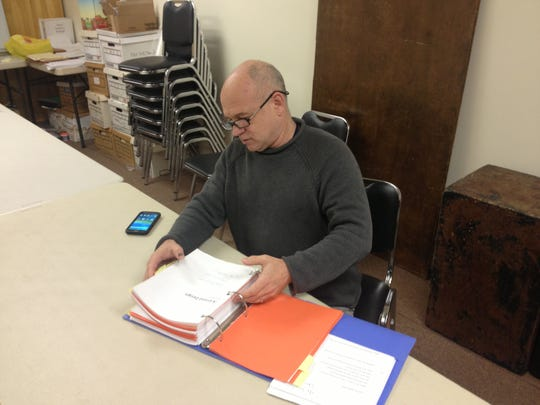 John Pietrowski, co-founder and artistic director of Playwrights Theatre, works at the professional company's offices at the Madison Civic Center.