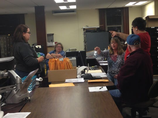 Members of the Randolph County Election Board work on tallying votes during Tuesday's midterm election.