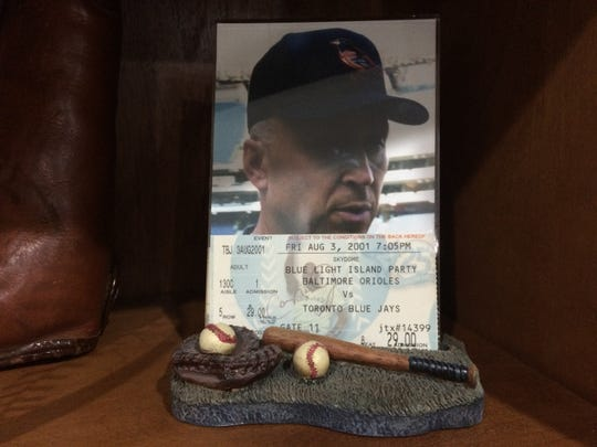 When Kris got a chance meeting with Ryan's hero, Cal Ripken, Jr., all she had for him to sign was a ticket stub, which is now on display in the Berry house, along with a picture she snapped after she got his autograph.