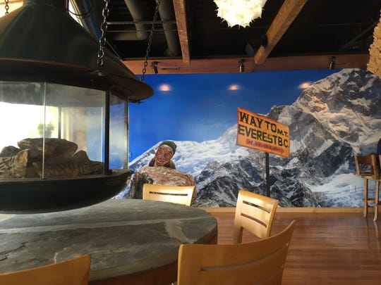 Embers Ski Lodge opened Monday in 12South. The bar and restaurant is inspired by the Ajax lift at Aspen Mountain and a spring skiing deck party at Val D'Isere in France.