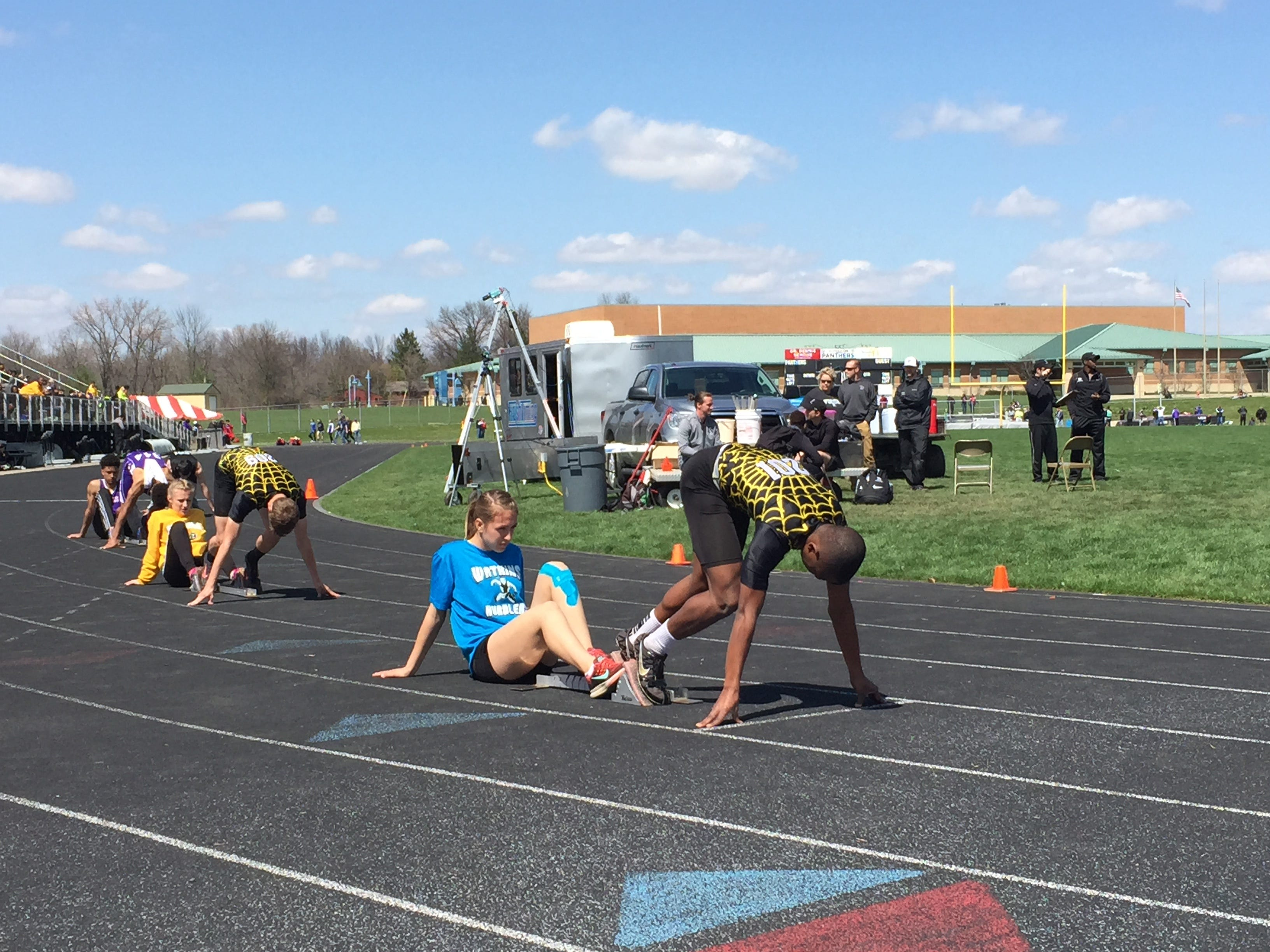 Watkins Memorial's Chance Abbitt, back, and Desmond Melson get set to start the 400 during the Stingel Invitational at Pickerington North on April 11. Abbitt and Melson are two of central Ohio's best in the event.