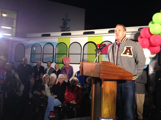 Palm Springs Mayor Steve Pougnet addresses the crowd during the launch of the BUZZ trolley Friday with a slew of seated celebrities, including Suzanne Somers, Lily Tomlin and Carol Channing.