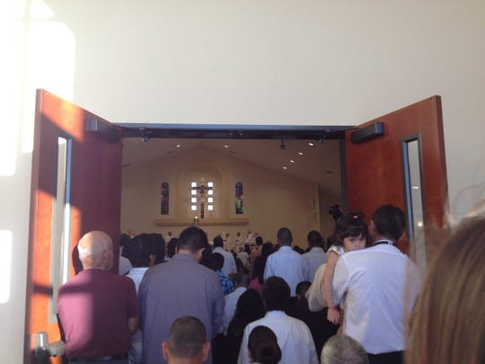 Parishioners celebrate the dedication of the New Our