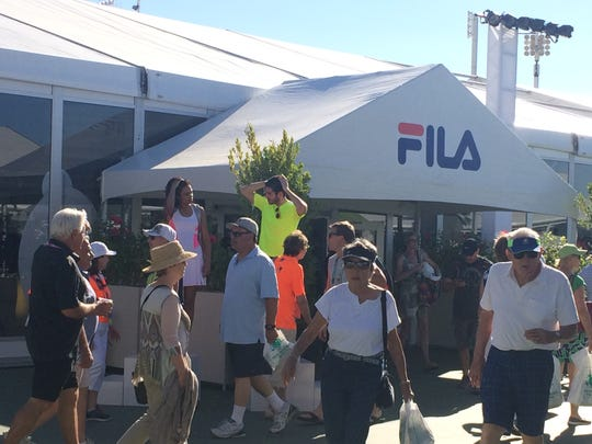 People shop at the Fila tent at the Indian Wells Tennis Garden.