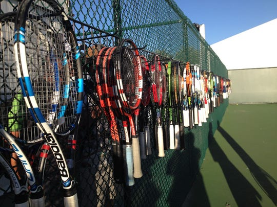 Demonstration tennis rackets are on display at the Tennis Warehouse at the Indian Wells Tennis Garden.