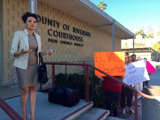 Attorney and community activist Rosa Elena Sahagún speaks out against immigration fraud on the steps of the Palm Springs courthouse on March 13.