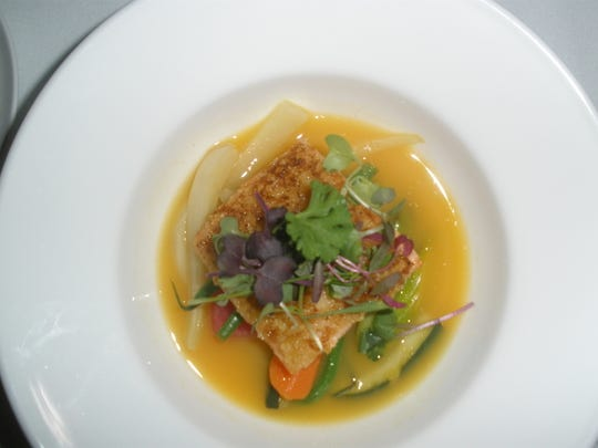The menu at Citron at The Viceroy in Palm Springs features Scottish salmon wtih citrus broth and seasonal vegetables.