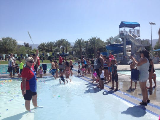 Parents and children prepare to dash into the water for the youngest underwater Easter egg hunt on Easter Sunday at the Palm Desert Aquatic Center.