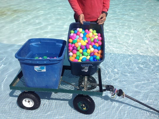 "Palm Desert Aquatic Center staff prepare ""environmentally friendly"" Easter eggs to be used in their annual underwater hunt."