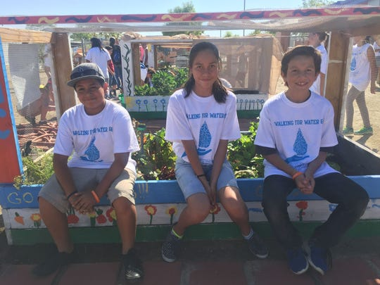 "Walter Coronado,11, Aleydis Carreno, 12, and Andres Vega, 12, all sixth graders at Nellie N. Coffman Middle School took part in the ""Walking for Water"" event on Saturday."