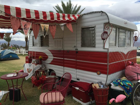 Vintage trailers from the 1940s and 1950s are displayed on the banks of Lake Eldorado at the Stagecoach festival grounds on Saturday, April 25, 2015.