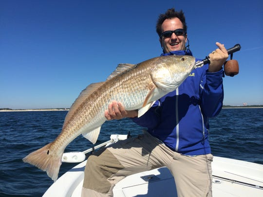 Angler Greg Prusiewicz with a nice bull redfish he caught while fishing with Captain Tyler Massey in Pensacola Bay.