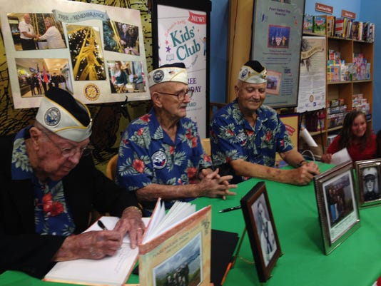 Pearl Harbor vets Frank Emond, Cass Phillips, Bill Braddock, left to right.